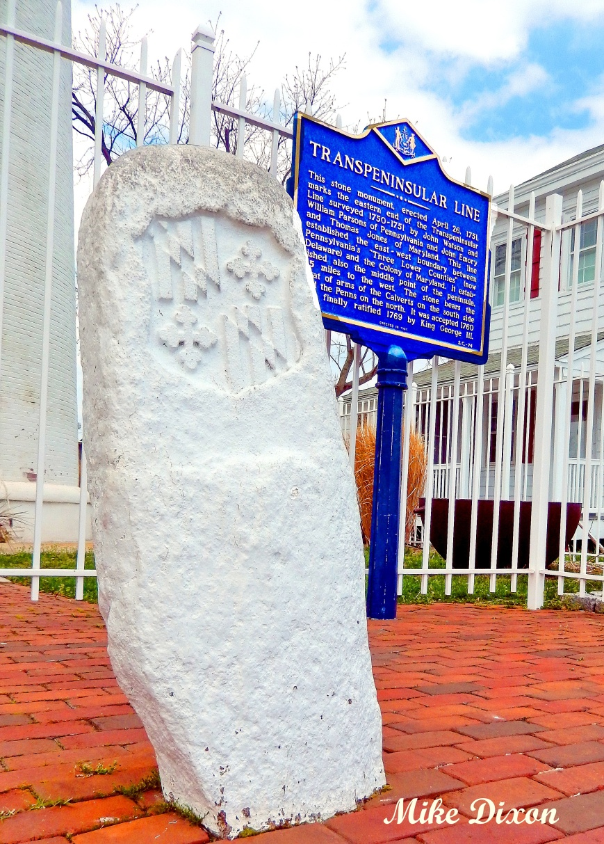 A waist high stone marks the Transpeninsular LIne between Delaware and Maryland