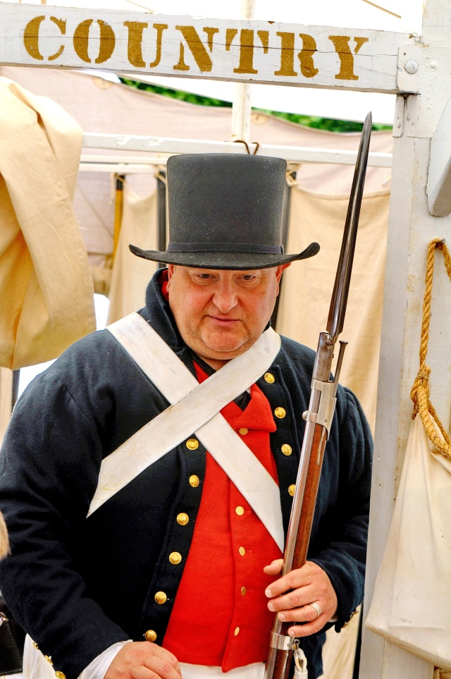 A reenactor from the Ship's company talks to visitors to his tent.  www.shipscompany.org
