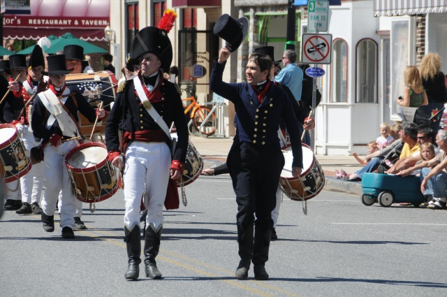 Vince Vaise, from the National Park Service, parades through the streets with the Fort McHenry Guard