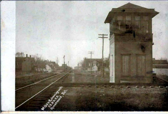 The railroad junction and tower in Greenwood.  A postcard, circa 1908.  Source Delaware Public Archives:  https://www.flickr.com/photos/delawarepublicarchives/8679818901/in/photostream/